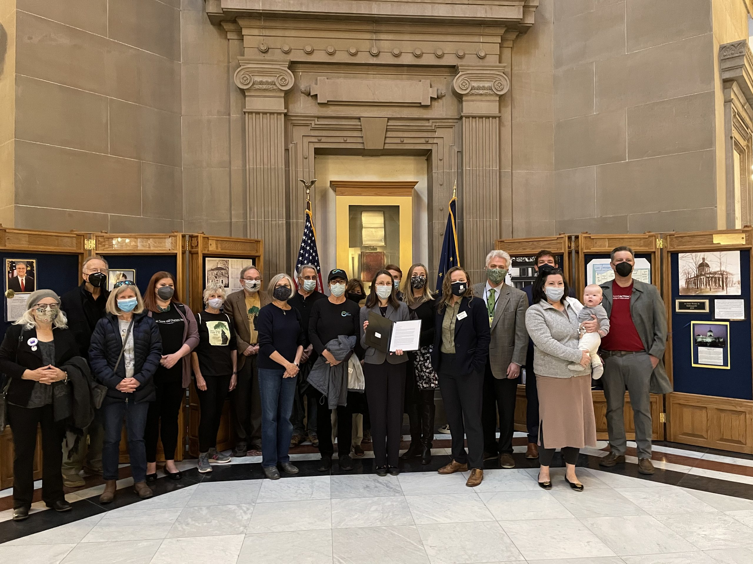 Delivering the veto letter to Governor Holcomb